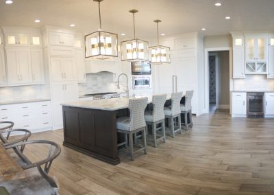 Cabinets are Brown Maple-Pure White. Island is Natural Birch-Timber.