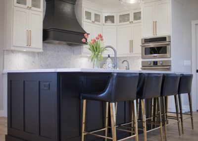 Island & Range Hood are Maple with Black. Cabinets are Maple with Pure White.