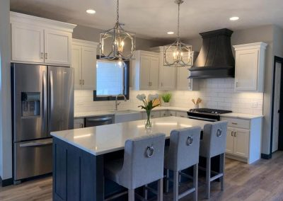 Island & Range Hood are Grizzle Gray with Black Breakaway Cabinets are Brown Maple with White Dove.