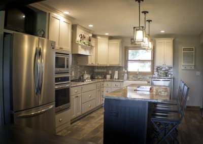 Cabinets are Brown Maple with Agreeable Gray and Anew Glaze. Island is Natural Birch with Timber Stain.