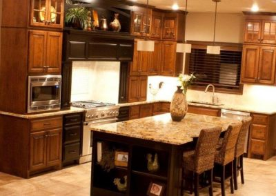 Cabinets are Natural Birch Minx with Glaze. Island Is Brown Maple Black-Colored Lacquer Slight Rub through to Minx Color.