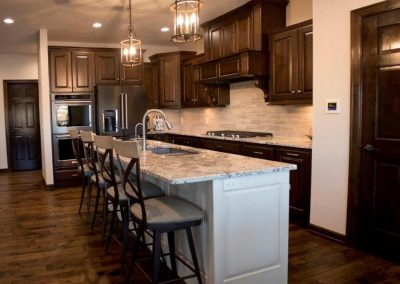 Cabinets are Rustic Cherry Amaretto. Island Is Alabaster with Light Mocha Glaze.