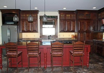 Cabinets are Rustic Cherry Homestead with Glaze. Island is Brown Maple Tinted with Glaze.