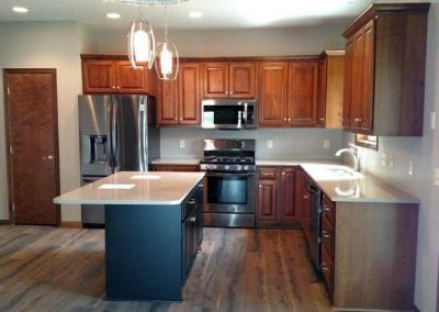 Cabinets are Rustic Cherry Truffle with Glaze. Island is Brown Maple Black with Light Rub through on Edges.