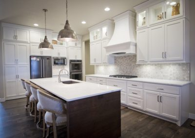 Cabinets are Brown Maple, Pure White. Island is Natural Birch with Saddle Stain.