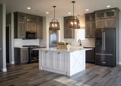 Cabinets are Natural Birch-Driftwood. Island is Rustic Cherry-Pure White.